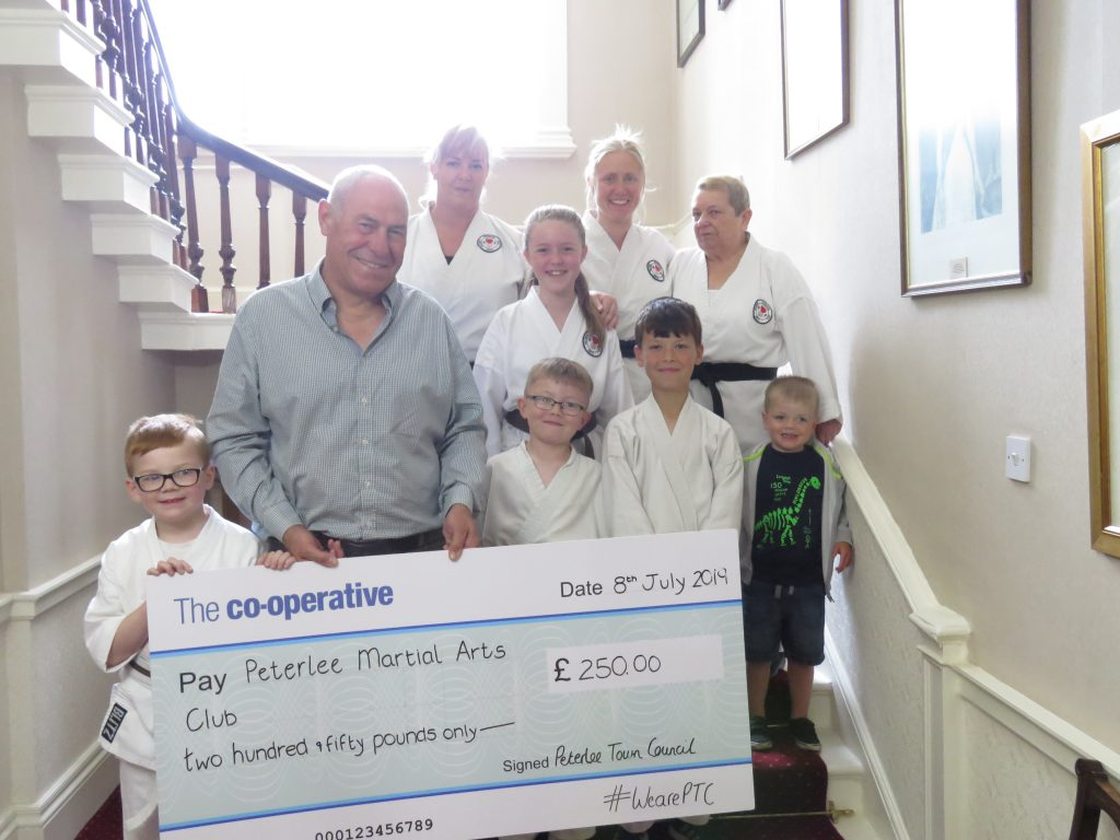 Photo of your Mayor with members of the Peterlee Martial Arts Club holding a large cheque