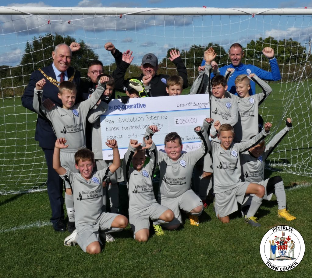 Photo of your Mayor with members of Evolution Peterlee football club holding a large cheque