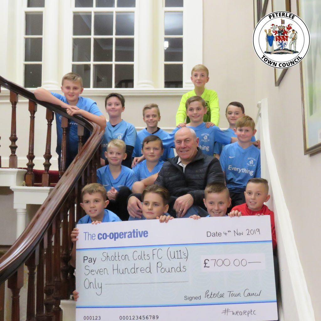 Photo of your Mayor with members of the Shotton Colts football club holding a large cheque