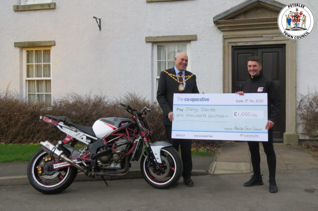 Photo of your Mayor with Jonny Davies holding a large cheque