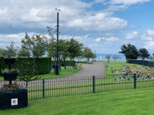A picture of the cemetery with the sea in the distance