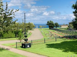 A picture of the cemetery with a view of the sea in the distance