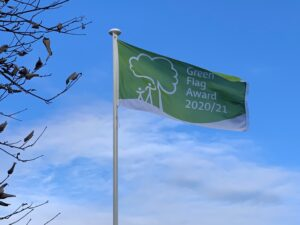 A picture of the cemetery flying their green flag award 2020 flag